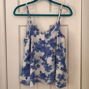 White/blue floral patterned sleeveless blouse